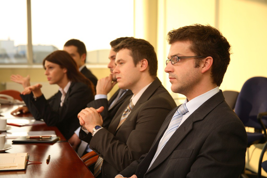five professional people at the formal meeting.